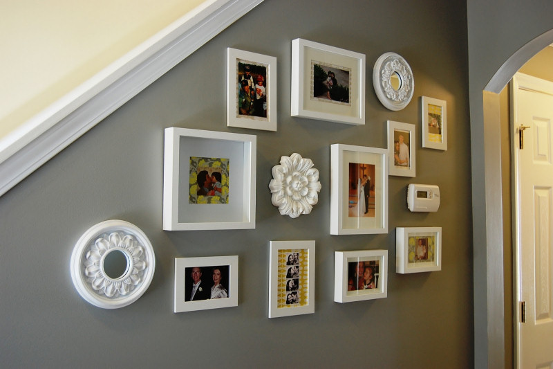 Instead of covering that ugly old thermostat, get creative with your wall decor to conceal and beautify it!